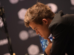 Carlsen impone su genio ante Caruana