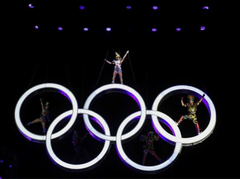 Suga reaffirms Tokyo will host Olympics despite new state of emergency